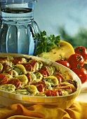 Potato, bacon, courgette, &  tomato casserole with oregano