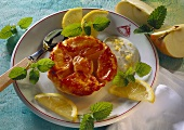 Mini-apple tart with lemon cream, lemons & lemon balm
