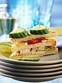 Club sandwich with chicken, eggs, tomatoes & cucumber