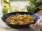 Pan-cooked potato dish with bacon & spring onions