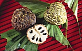 Three Cherimoyas; One Sliced