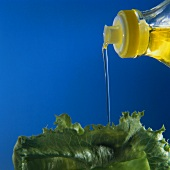 Pouring Oil Over Lettuce