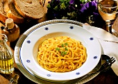 Spaghetti with saffron sauce and parsley sprig