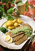 Beef with herb egg sauce and potatoes in their skins