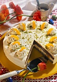 Easter cake with poppy seeds, orange segments & pistachio