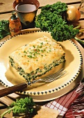 Kale casserole with cheese topping & snipped chives