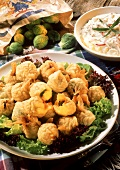 Fried Brussels sprouts on lettuce with vegetable & yoghurt dip