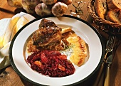 Lamb shank with red cabbage & apricots and potato gratin