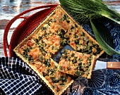 Spring onion tart with smoked salmon in baking dish