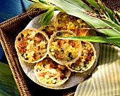 Ham and sweetcorn tartlets on plate with maize plant
