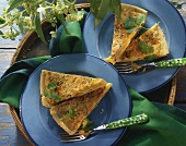 Carrot & bacon quiche with coriander, two pieces on plates