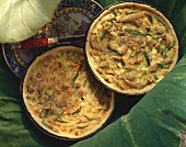 Peanut quiche with turkey (two quiches in baking dishes)