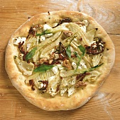 Fennel pizza with walnuts, goat's cheese, dried tomatoes