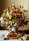 Floral Arrangement with a Full Dish of Strawberries