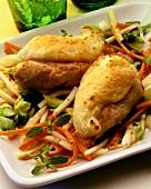 Baked chicken breast fillets on julienne vegetables