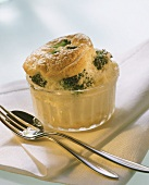 Cauliflower & broccoli souffle in glass dish; fork & spoon