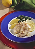 Redfish with hazelnut butter, spinach, potatoes and lemon