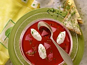 Beetroot consomme with egg white dumplings & apple slices