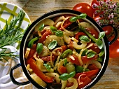 Braised cucumber ratatouille with basil in stew pot