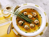 Game broth with liver dumplings and chives