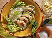 Steamed chicken parcels in iceberg lettuce with celery sauce