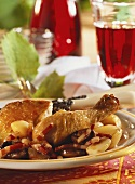 Coq au vin with bacon, onions and garlic on plate