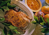Roast duck with orange zest & orange sauce in bowl