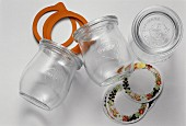 Three empty preserving jars, labels & wide elastic bands
