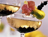 Summer wine cocktail with blackcurrants, prosecco