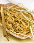 Spaghetti with lemon & lamb ragout and dandelion