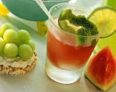 Watermelon drink with lime & rice wafer with honeydew melon