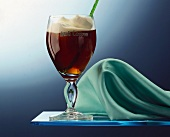 Irish coffee with cream in Irish coffee glass