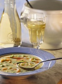 Potato soup with salmon and spring onions