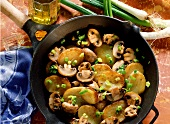 Pan-cooked potato dish with mushrooms & spring onions