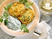 Small courgette & potato pancakes with yoghurt & herb sauce