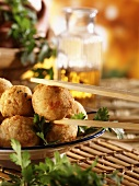 Deep-fried sweet potato balls on plate & chopsticks