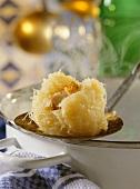 Thuringian dumplings on ladle on edge of pot