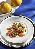 Pork medallions in grapefruit sauce with wild rice mixture