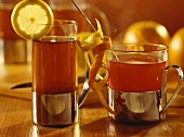 Lemon & elderberry tea & wine & orange punch in tea glasses