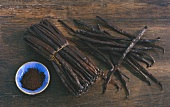 Vanilla pods, tied together and singly, and vanilla pulp