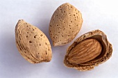 Two whole unshelled almonds and half an almond