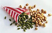 Pistachio kernels in a paper bag & unshelled pistachios