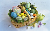 Various coloured Easter eggs in basket
