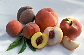 Various types of peach, whole and cut open