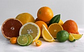 Various citrus fruits, whole and sliced