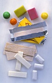 Various types of chewing gum, some in wrappers