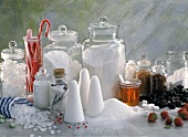 Still life with various types of sugar, candy canes, syrup