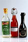 Rice, raspberry and balsamic vinegar in bottles