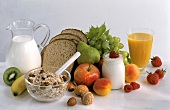 Ingredients for healthy breakfast (muesli, fruit, milk, juice)