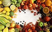 Many different types of fruit arranged round edge of picture